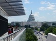Kathy at the Newseum with Capitol behind